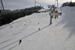 Chairlift And Skiers Royalty Free Stock Photos