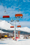 Chairlift  on background of snowy mountains in the High Tatras Royalty Free Stock Photography