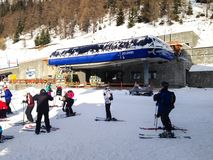 Chairlift cable car and ski slopes in the mountains of Courmayeur winter resort, Italian Alps stock image
