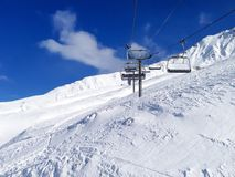 Chairlift cable car and ski slopes in the Stock Image