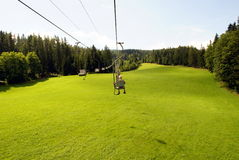 Chairlift. A chair lift ride to the mountains Royalty Free Stock Images