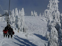 Chairlift and fresh snow Stock Photography