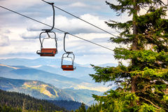 Chairlift going over trees in the summer on Mountain. Carpathian Stock Photos