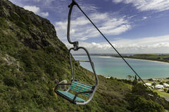 Chairlift. Going up the side of a mountain Royalty Free Stock Photos