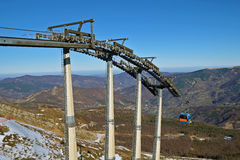 Chairlift mechanical pulleys in ski resort Stock Photography