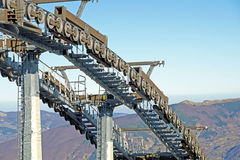 Chairlift mechanical pulleys in ski resort Stock Images