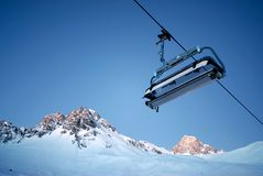 Chairlift and mountain royalty free stock image