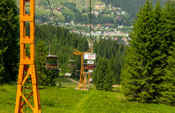 Chairlift on a mountain landscape Stock Photography