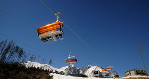Chairlift and mountain with nice blue sky Royalty Free Stock Photo
