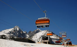 Chairlift and mountain with nice blue sky Royalty Free Stock Photos