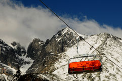 Chairlift and mountain with nice blue sky Stock Photos