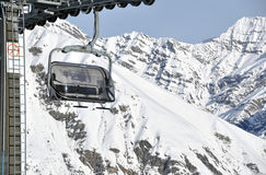 Chairlift and mountains Stock Photography