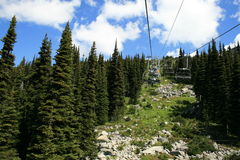 chairlift in mountains in Whistler, BC Royalty Free Stock Photos