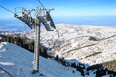 Chairlift in mountains in winter in  Ak Bulak, Almaty, Kazakhstan Royalty Free Stock Photography