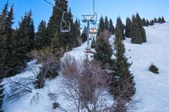 Chairlift in mountains in winter in  Ak Bulak, Almaty, Kazakhstan Royalty Free Stock Images