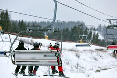 Chairlift with people at ski resort. royalty free stock photos
