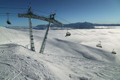 Chairlift for 4 persons on Southern slope of Rosa Peak 2320 meters above sea level Stock Images