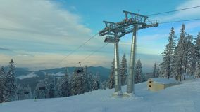Chairlift in Poiana Brasov resort, Romania stock video footage