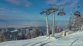 Chairlift in Poiana Brasov resort, Romania stock video