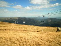 Chairlift in Romania. A beautiful view over chairlift and nature in Romania royalty free stock photography
