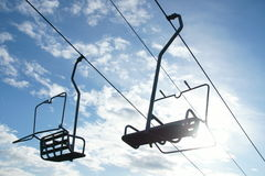Chairlift seats in sunshine Stock Photography