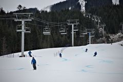 Chairlift and ski instructors on snow mountain Stock Images
