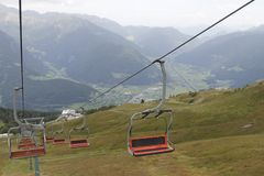 Chairlift. Ski lift in european Alps. Transporting hikers in summer season Stock Images