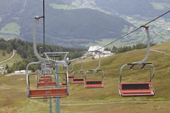 Chairlift. Ski lift in european Alps. Transporting hikers in summer season Stock Photos
