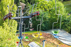 Chairlift ski lift in European Alps. Transporting hikers in summer season Royalty Free Stock Photo