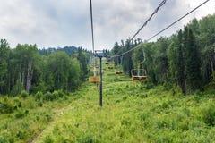 Chairlift ski lift on Kokuya Mountain. Altai Republic. Russia Stock Photos