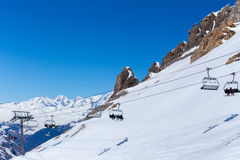 Chairlift on a ski resort. Mountain landscape and the ski lifts and rocks. Tignes, France Stock Photo