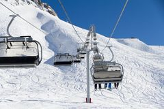 Chairlift on a ski resort Stock Images