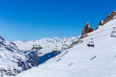 Chairlift on a ski resort. Tignes, France. Mountain landscape and the ski lifts and rocks. Tignes, France Stock Photo