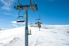Chairlift on ski slope in the mountains Royalty Free Stock Image