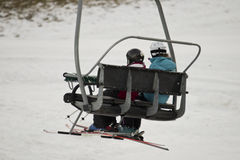 Chairlift with skiers Royalty Free Stock Photo