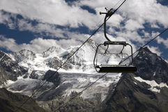 Chairlift with snow mountains Stock Image