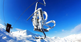 Chairlift after a snow storm, extreme weather Royalty Free Stock Photo