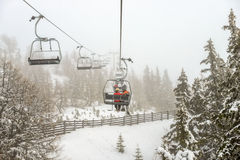 Chairlift in snowfall at alpine ski resort Royalty Free Stock Images