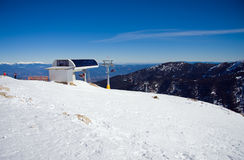 Chairlift in snowy mountains Royalty Free Stock Photo