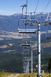 Chairlift in Summer. An empty chairlift at a ski resort during the summer Stock Images