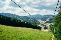 Chairlift in summer mountains stock images