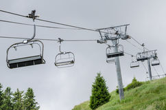 Chairlift system on mountain slope Stock Photography
