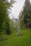 Chairlift to Mogosa peak under the clouds. Royalty Free Stock Images
