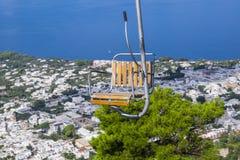 Chairlift Up to Mount Solaro in Anacapri Italy. Closeup of Chairlift to Mount Solaro in Anacapri Italy Stock Photo