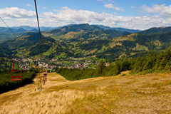 Chairlift view over mountain town Stock Images