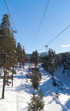 Chairlift in winter forest in Sarikamis. Chairlift in winter forest in sunny day. Sarikamis Royalty Free Stock Photos