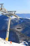 Chairlift on winter resort Royalty Free Stock Image