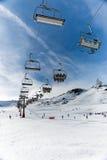 Chairlift in winter resort Stock Photos