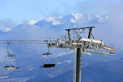 Chairlift on winter resort Royalty Free Stock Photos