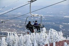 Free Chairlift With People At Stowe Ski Resort In Vermont, View To The Mansfield Mountain Slopes Stock Images - 205924304